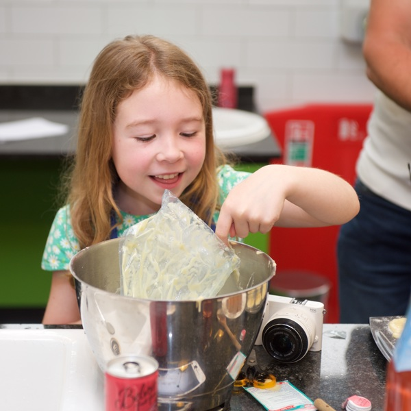 Kids enjoying baking in the Cookery School