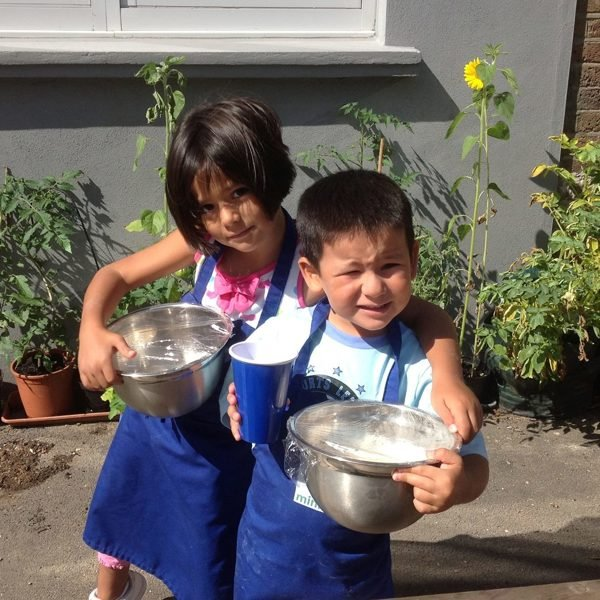 Children with mixing bowls